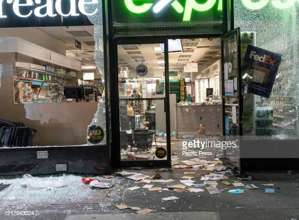 View of Duane Reade Pharmacy store broken windows and looted Protests turn into looting and destructions in Manhattan before first curfew imposed