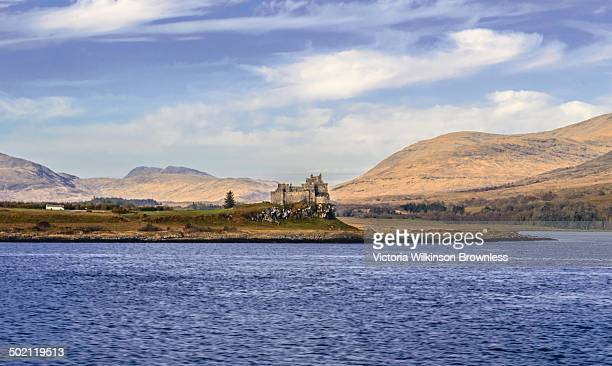 View of Duart Castle taken from the Sound of Mull, with mountains on the island of Mull rising behind. Taken Craignure, Mull, Scotland, UK.