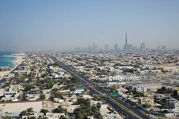 View of Dubai residential areas along Jumeirah Beach with Burj Dubai the world's tallest building rising in the background