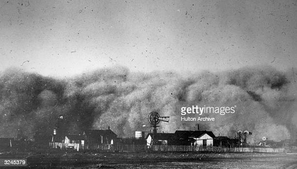 View of dust clouds rolling over a farm on a country plain during a sandstorm Midland Texas