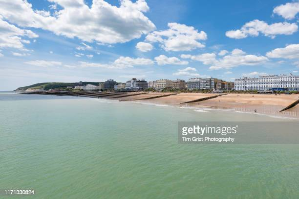 view of eastbourne seafront and beachy head in the distance, east sussex, uk - eastbourne stock pictures, royalty-free photos & images