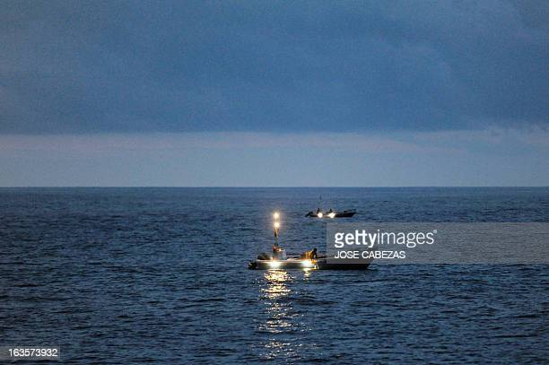 View of Ecuadorean fishing boats on March 3 2013 during a drug interdiction while patrolling in international waters near Colombia and Ecuador in the...