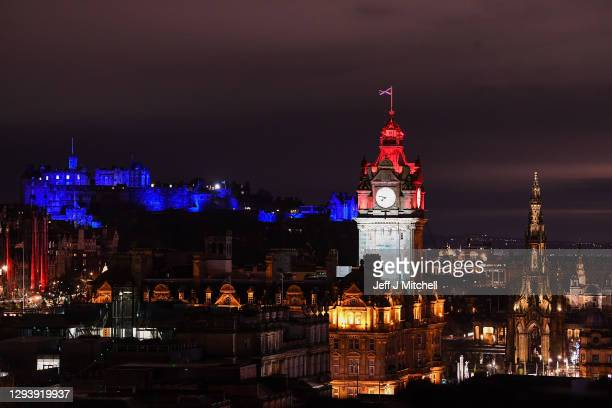 View of Edinburgh Castle and the Balmoral Clock tower on Hogmanay on December 31, 2020 in Edinburgh, Scotland. Members of the public have been urged...