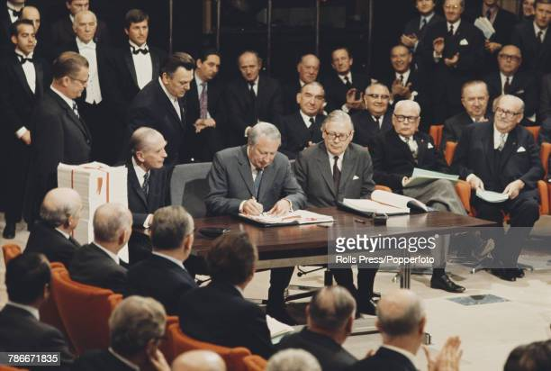 View of Edward Heath Prime Minister of the United Kingdom signing the accession treaty for the United Kingdom to join the European Economic Community...