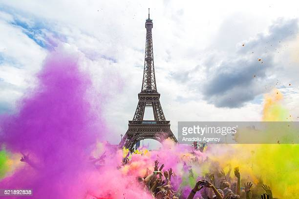 A view of Eiffel Tower is seen during people covered in colourful chalk powder dance at the finish line after taking part at the event of Color Run...