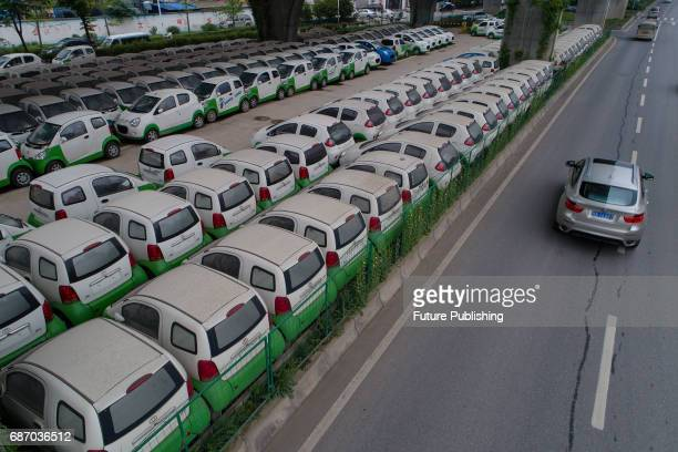 A view of electric cars owned by a local carsharing company on May 22 2017 in Wuhan China About 200 neverused electric cars have been parked in the...