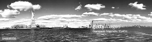 view of ellis island and statue of liberty - ellis island stock pictures, royalty-free photos & images