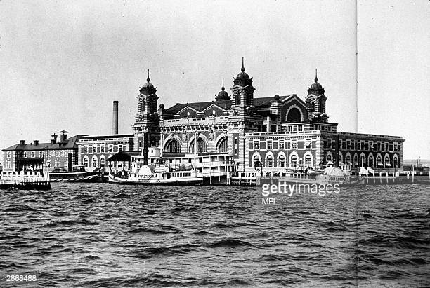 View of Ellis Island in New York Bay, run by the US Immigration Service. Between 1892 and 1954 over 20 million immigrants to the USA passed through...