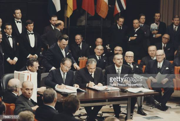 View of Emilio Colombo Prime Minister of Italy signing the accession treaty for Denmark Norway Ireland and the United Kingdom to join the European...