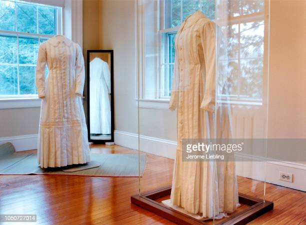 View of Emily Dickinson's only existing white dress on display in a glass case at the Dickinson Homestead Amherst Massachusetts 1989 A replica of the...
