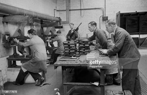 View of employees testing brand new recently manufactured Bren light machine guns on a firing range at the Royal Small Arms Factory in Enfield north...