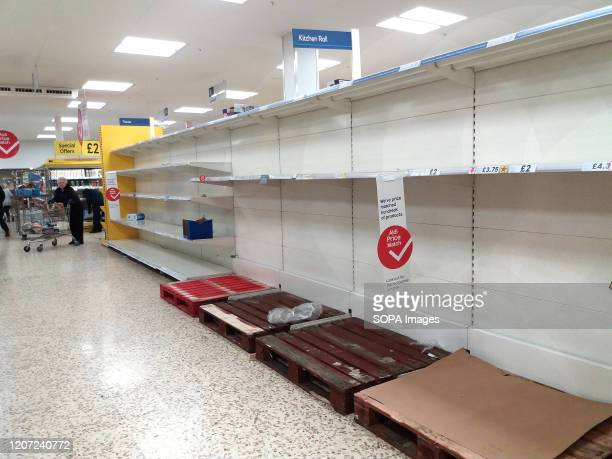 View of emptied toilet and kitchen roll pack shelves at a supermarket amid covid19 Coronavirus fears in London