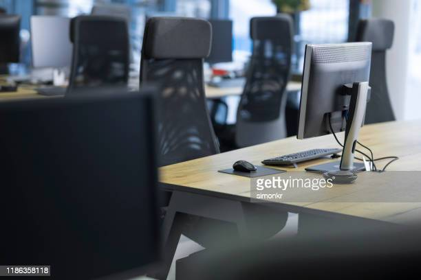 view of empty call centre office - empty desk stock pictures, royalty-free photos & images