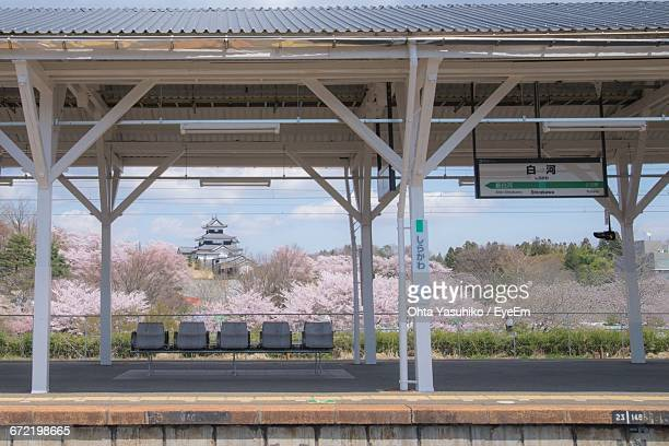 view of empty chairs on railway station platform - 駅 ストックフォトと画像