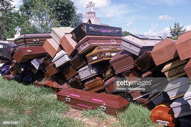 View of empty coffins piled in a graveyard, Guayabal, Colombia, mid November 1985. The coffins were gathered for the victims of the mudslide set off...