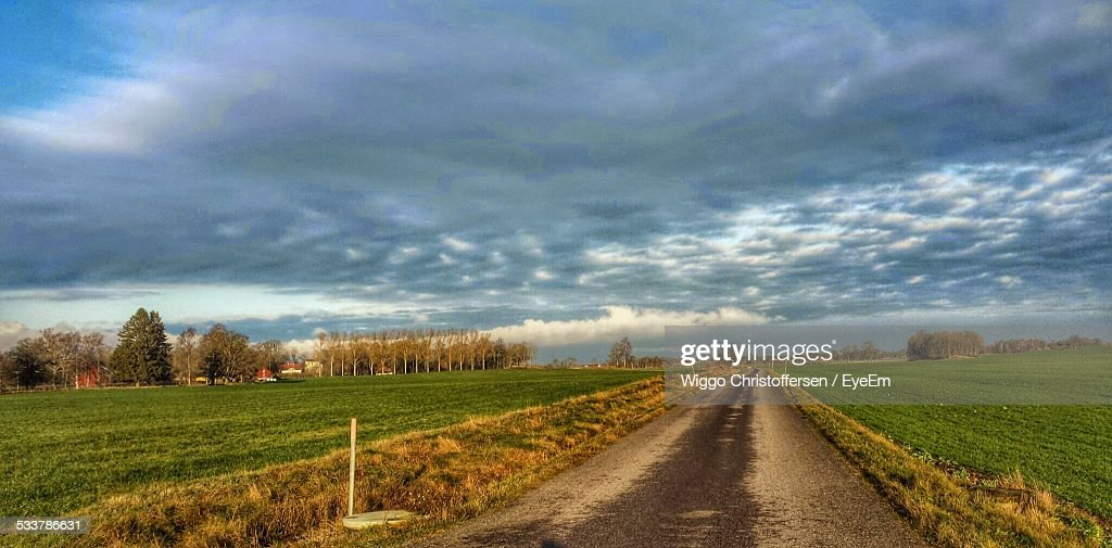 View Of Empty Country Road On Cloudy Day : Foto stock