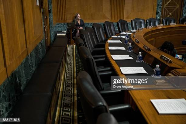 A view of empty Democrat seats during a meeting of the Senate Finance Committee to vote on the nominations of cabinet nominees Tom Price and Steve...