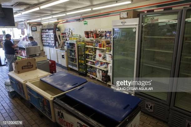 View of empty fridges and freezers in a store due to the shortage of beer after the breweries countrywide closed their production due to the COVID19...