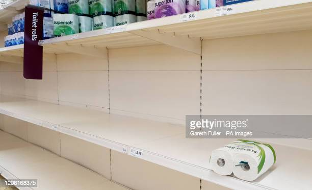 A view of empty shelves as toilet roll is almost sold out in a supermarket in Ashford Kent UK shoppers are stockpiling toilet paper pasta hand...