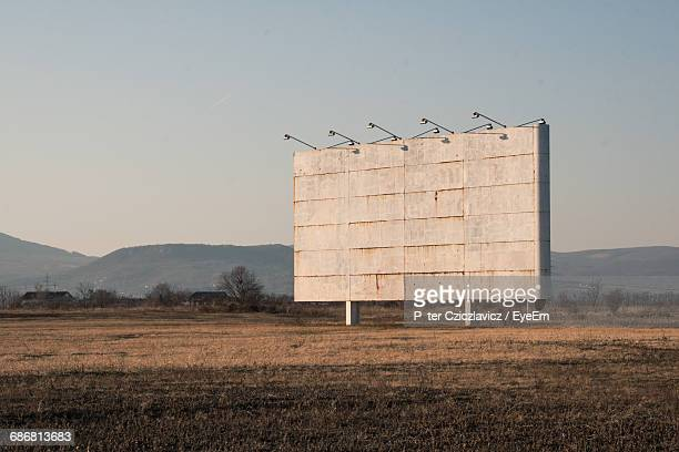 view of empty sign board on field - remote location stock pictures, royalty-free photos & images