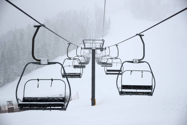 View of empty ski chair lift at Squaw Valley Resort on March 14, 2020 in Olympic Valley, California Alterra Mountain Company, which owns Squaw Valley...