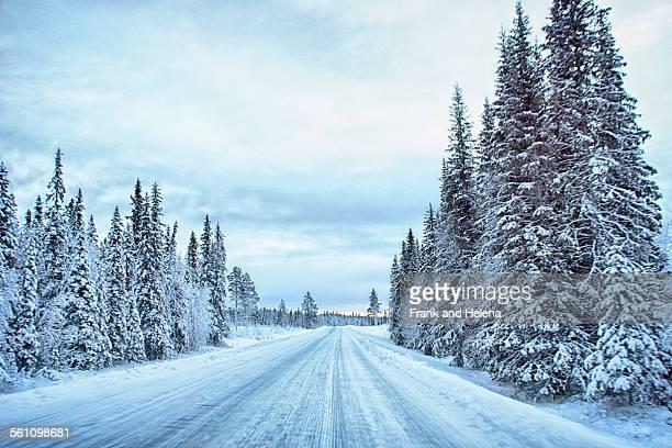 View of empty snow covered highway, Hemavan, Sweden