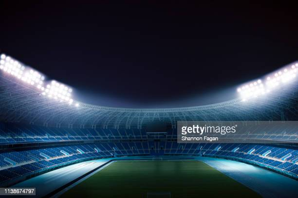 view of empty stadium at night - stadion stockfoto's en -beelden