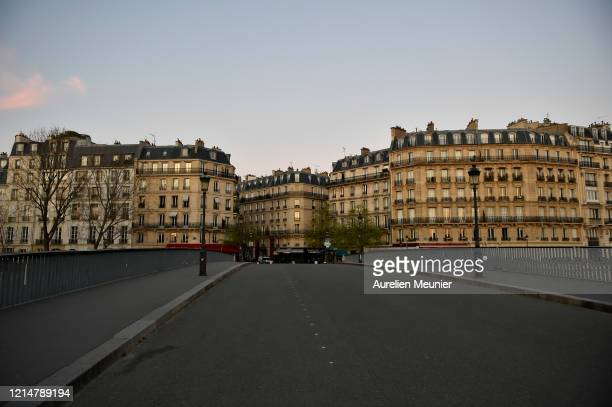A view of empty street on Ile de La Cite on March 25 2020 in Paris France The country has introduced fines for people caught violating its nationwide...