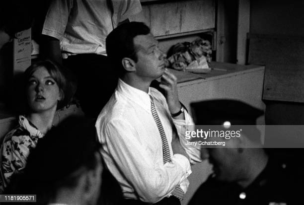 View of English band manager Brian Epstein as he sits in the dugout of Shea Stadium, New York, New York, August 15 New York, New York, August 15,...