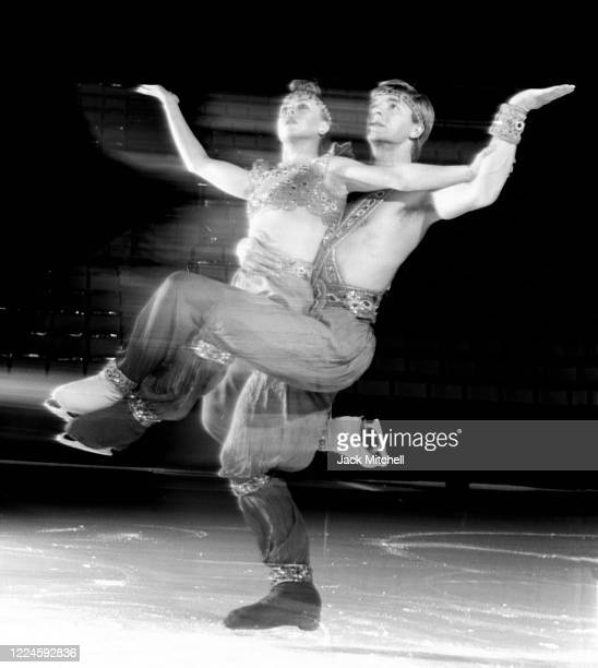 View of English figure skating duo Jayne Torvill and Christopher Dean as they perform on ice, November 1986. The pair were the 1984 Olympic gold...