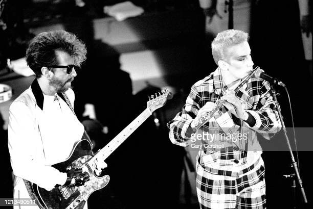 View of English musician Dave Stewart on guitar and Scottish musician Annie Lennox on flute both of the group Eurythmics perform onstage at the Ritz...