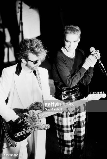 View of English musician Dave Stewart , on guitar, and Scottish musician Annie Lennox, both of the group Eurythmics, perform onstage at the Ritz, New...
