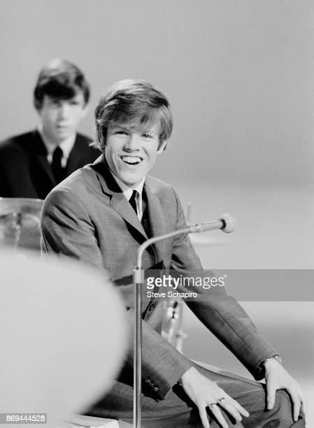 View of English musician Peter Noone of the group Herman's Hermits as he laughs New York New York 1965 Visible behind him is fellow bandmate Barry...