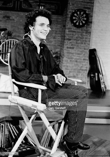 View of English New Wave musician Adam Ant as he sits in a director's chair during an interview at MTV Studios New York New York September 9 1981
