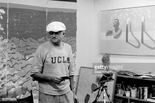 View of English Pop artist David Hockney as he holds a Polaroid photograph in his studio at Tyler Graphics Mount Kisco New York 1978 At the time he...