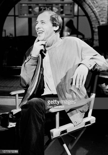 View of English Rock and Blues musician Mark Knopfler, of the group Dire Straits, as he sits in a director's chair during an interview at MTV...