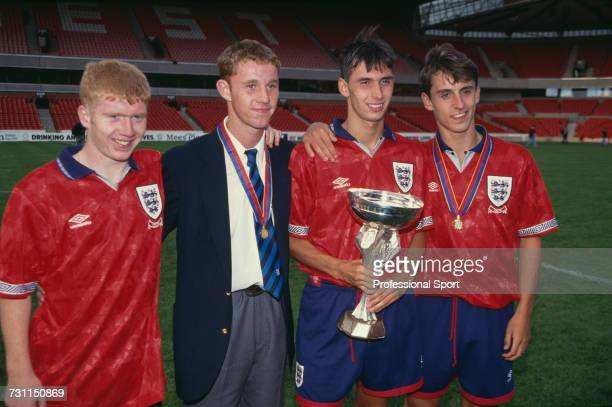 View of English under18 footballers from left Paul Scholes Nicky Butt Chris Casper and Gary Neville all Manchester United players pictured standing...