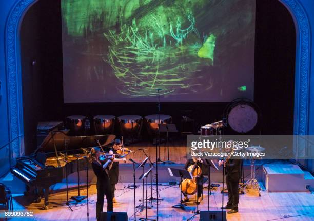 View of Ensemble Connect as they perform onstage during an 'Immigrant Voices' concert at Brooklyn's Roulette New York New York June 8 2017 Pictured...