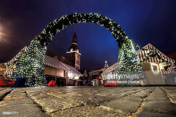 view of entrance to christmas market - riga stock pictures, royalty-free photos & images