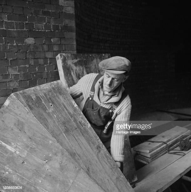 View of Ernest S. Stallard, a Laing joiner, working on the construction of Portishead 'B' Power Station. A cropped version of this image was...