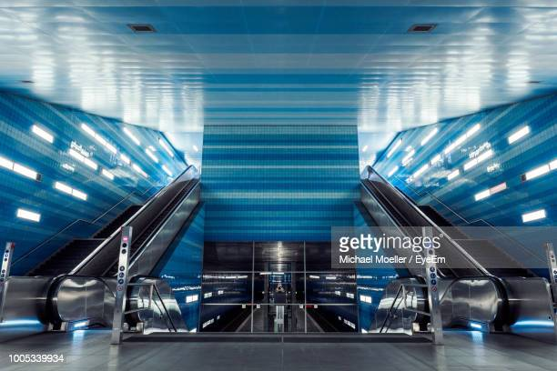 view of escalator at subway station - flughafenterminal stock-fotos und bilder