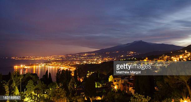 CONTENT] A view of Etna taken just after sunset from Taormina Sicily Italy