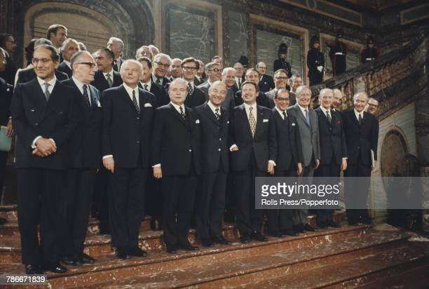 View of European leaders standing together in a group on the grand staircase of the Egmont Palace for the signing of the accession treaty by Denmark...