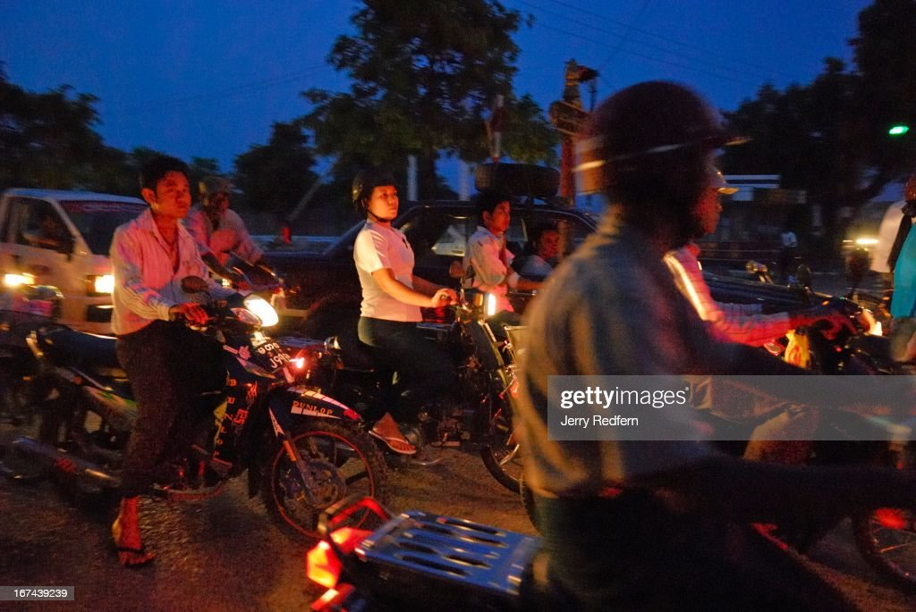 View of evening rush-hour traffic in downtown Mandalay, Myanmar..