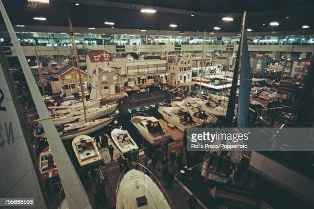 View of exhibits yachts and boats pictured on display in the pool area during the London Boat Show at Earls Court Exhibition Centre in London in...