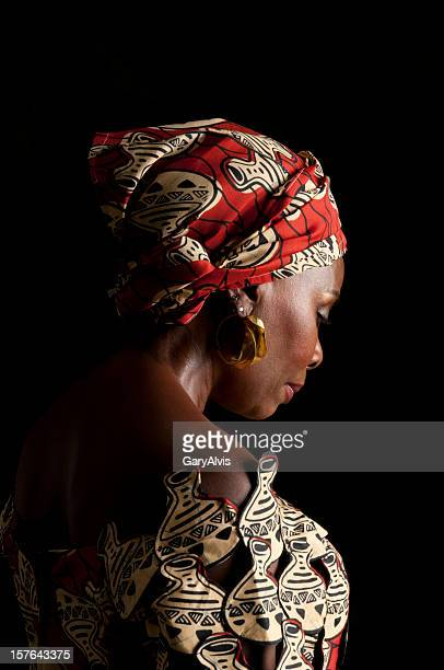 3/4 view of expressive African female in traditional dress/looking down