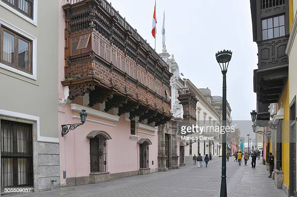 View of Exterior of Palacio de Torre Tagle on a typical overcast day with its intricate moorish woodworked balcony with the purpose to allow the...