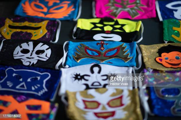 View of face masks from different Mexican Lucha Libre fighters on April 20 2020 in Puebla Mexico Due to the COVID19 pandemic Huerta turned to produce...