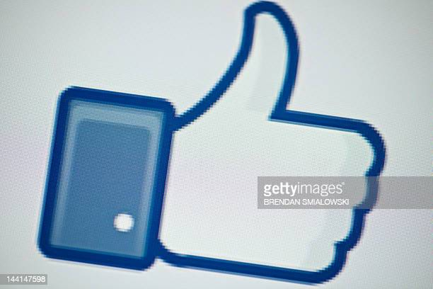 "View of Facebook's ""Like"" button May 10, 2012 in Washington, DC. Social-networking giant Facebook will go public on the NASDAQ May 18 with its..."