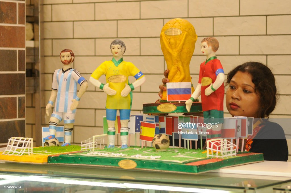 A view of famous Balaram Mullick & Radharaman Mullick Sweets shop decorated with a replica of World Cup trophy made with sweets to celebrate FIFA World Cup Football Tournament at the shop at Bhowanipore, Jagu Bazar, on June 14, 2018 in Kolkata, India. People enjoy the football fever.